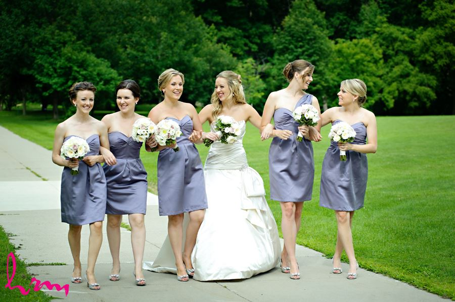 Bride with her bridesmaids in purple dresses at Western University