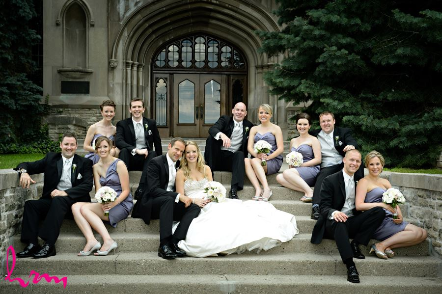 Bride and Groom with their bridal party on the steps of University College at Western University