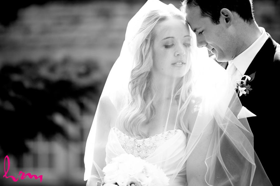 Bride and Groom cuddling into each other in black and white