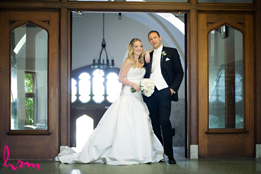 Bride and groom in doorway in University College at Western University