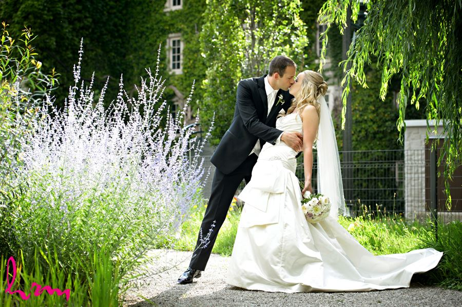 Bride and Groom having a romantic kiss at Western University