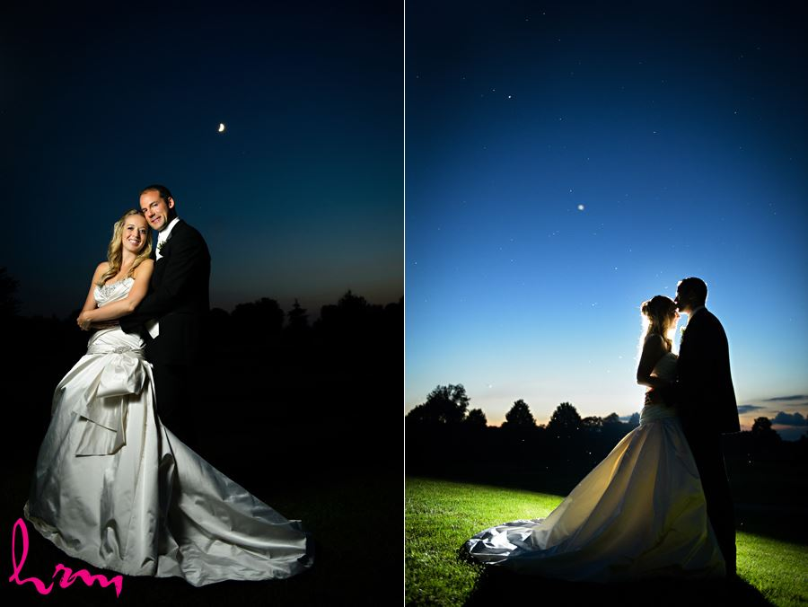 Groom kissing brides forehead in front of a starry night sky