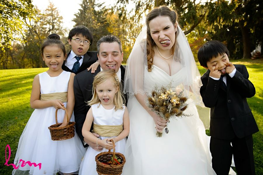 Flowergirls and ring-bearers with bride and grooms outside Windermere Manor London ON Wedding Photography