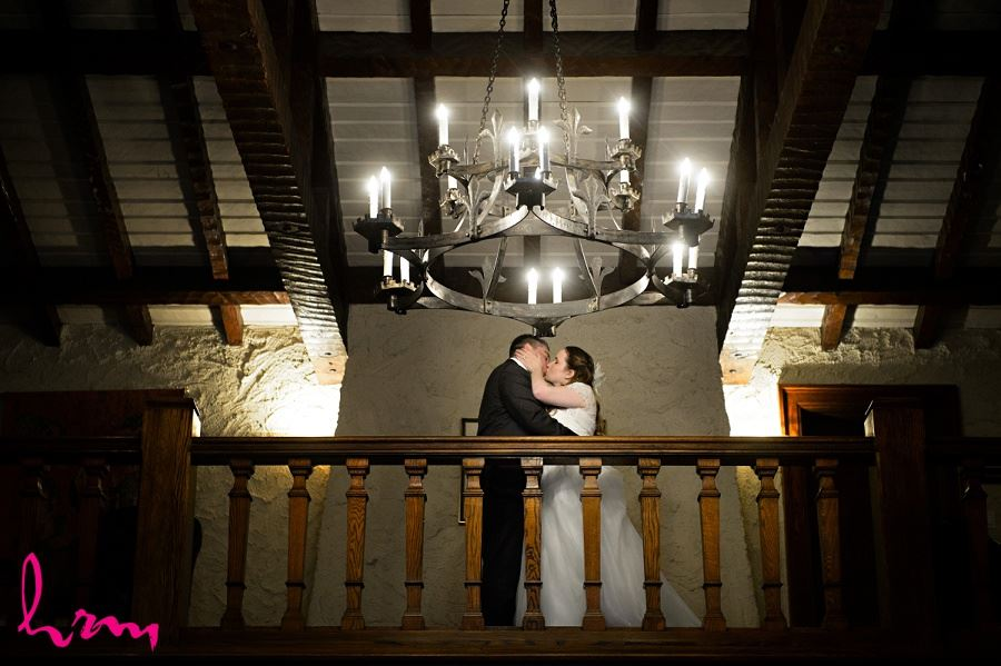 Grace and Matt on balcony at Windermere Manor London ON Wedding Photography