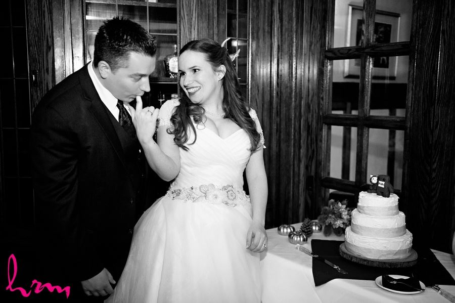 Trying the cake at Windermere Manor London ON Wedding Photography