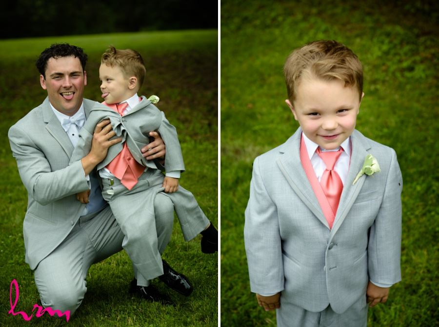 Ring bearer in gray suit and coral tie