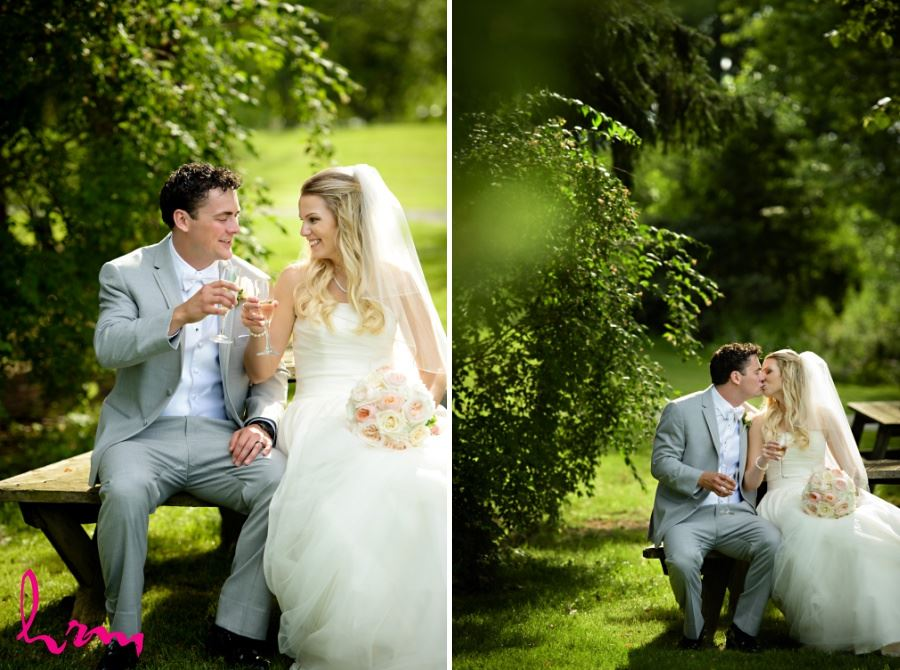 Bride and groom having champagne on wedding day after ceremony