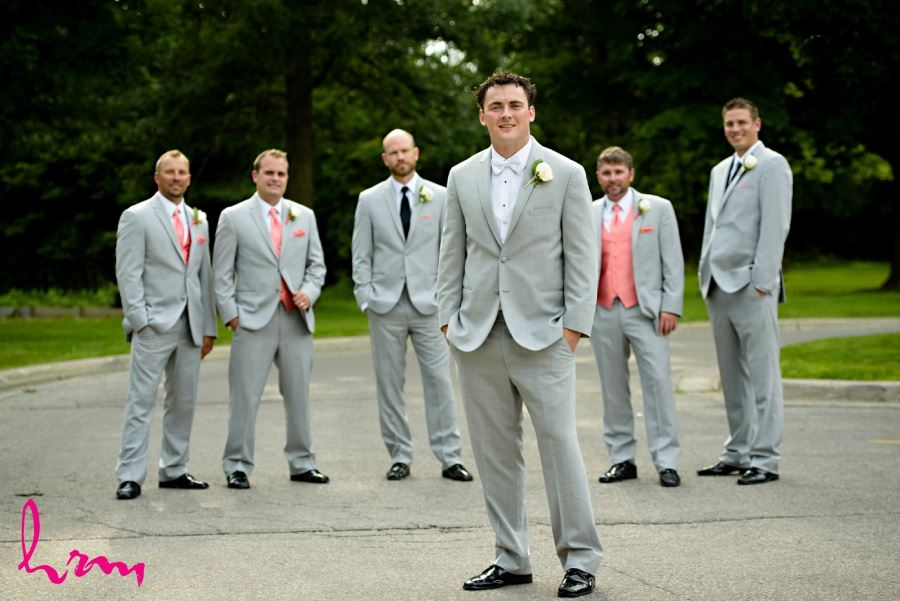 Groom with groomsmen in gray coral and black