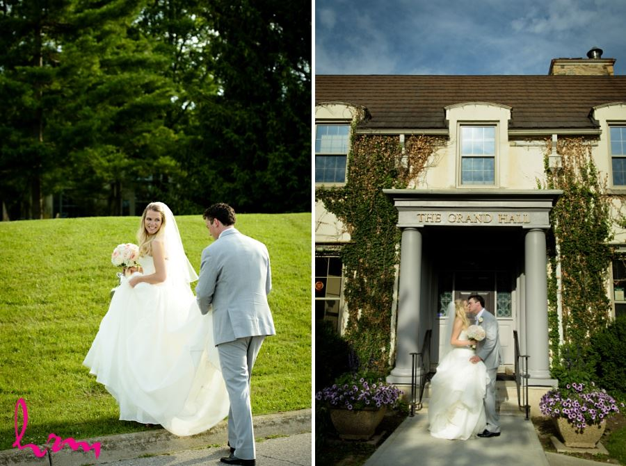 Bride and groom kissing in front of the grand hall windermere manor