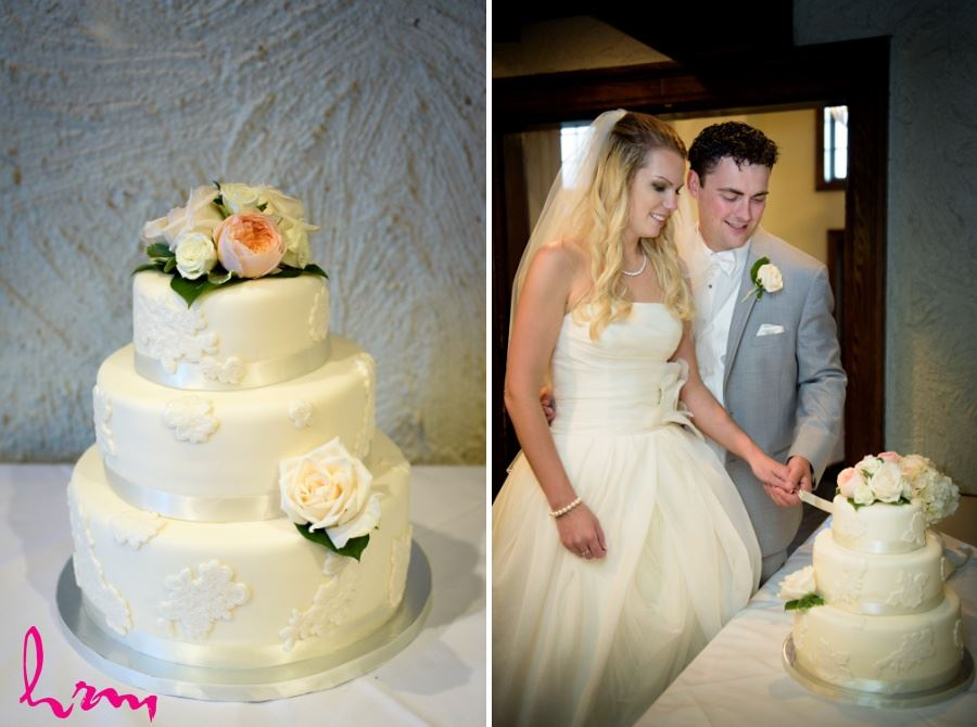 Simple three tier round wedding cake with ribbon and flowers roses