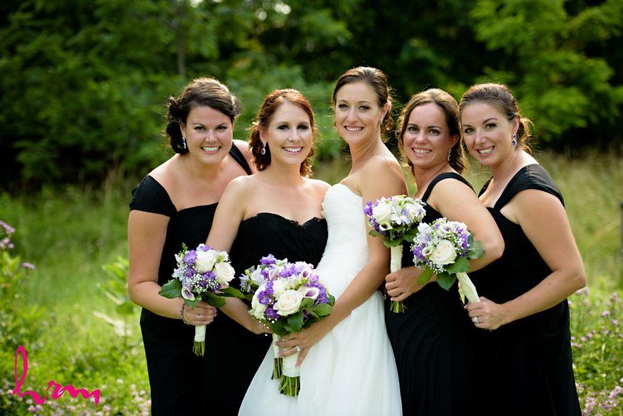 wedding bridal party black dresses purple bouquets